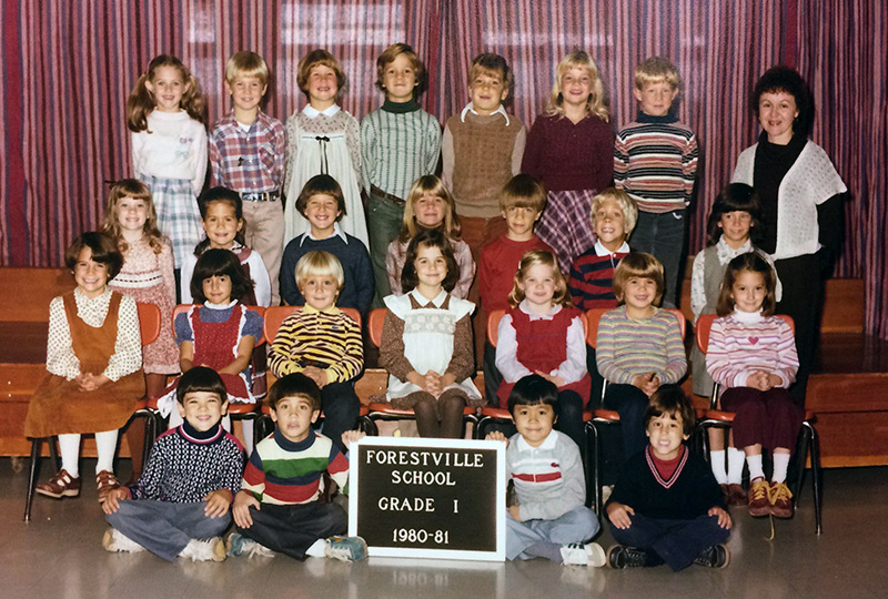 First grade class portrait from the 1980 to 1981 school year. 25 students and one teacher are shown.