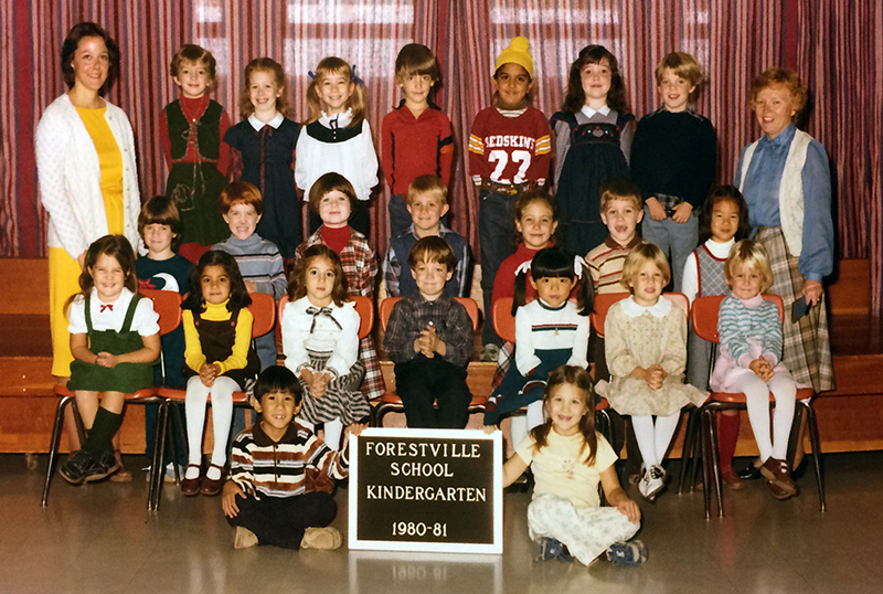 Kindergarten class portrait from the 1980 to 1981 school year. 23 students and two teachers are shown.