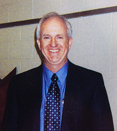 Head-and-shoulders portrait of Principal Harris taken during the 2003 to 2004 school year.
